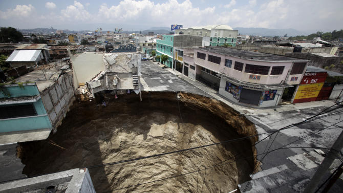 A giant sinkhole caused by the rains of tropical storm Agatha is seen in Guatemala City