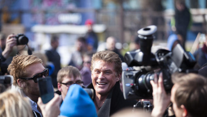 "US actor David Hasselhoff, center, arrives for a protest against the removal of a section of the East Side Gallery, a historic part of former Berlin Wall, in Berlin, Sunday, March 17, 2013. Hasselhoff is fondly remembered by many Germans for releasing a song called ""Looking for Freedom"" shortly before the fall of the Wall in 1989. (AP Photo/Markus Schreiber)"