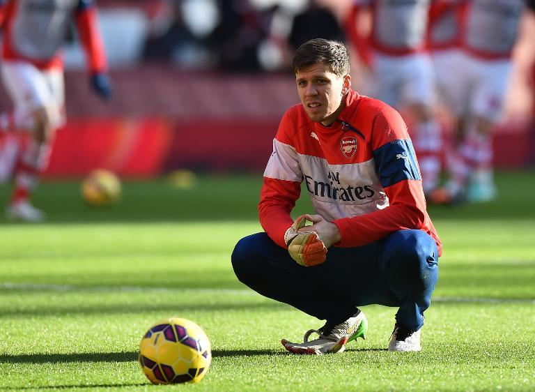 Arsenal's Polish goalkeeper Wojciech Szczesny takes a break during warm up ahead of the English Premier League football match between Arsenal and Stoke City at the Emirates Stadium in London on Ja