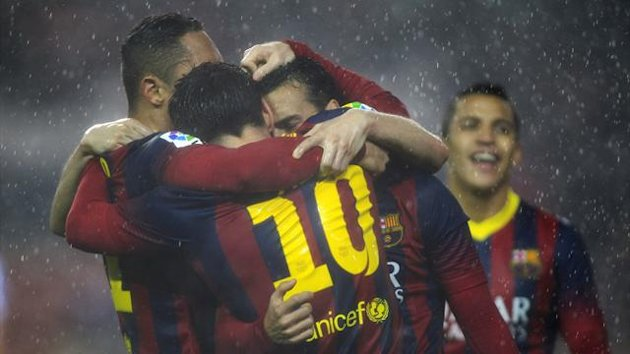 Barcelona's Lionel Messi (10) is congratulated by team mates after scoring against Sevilla during their Spanish First Division soccer match at Ramon Sanchez Pizjuan stadium in Seville, February 9, 2014 (Reuters)