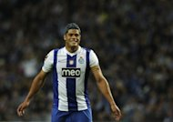 Porto striker Hulk, pictured in May 2012, AC Milan's Thiago Silva and Real Madrid defender Marcelo were on Thursday included as the three over-age players in Brazil coach Mano Menezes's squad for the Olympic Games
