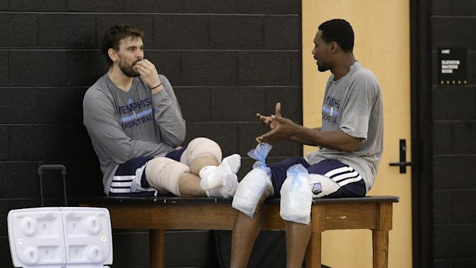 Memphis Grizzlies center Marc Gasol, left, talks with guard Tony Allen after a practice at NBA basketball training camp Tuesday, Oct. 1, 2013, in Nashville, Tenn. The Grizzlies are scheduled to hold training camp in Nashville through Saturday