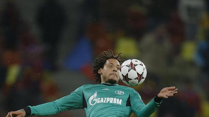 Schalke's Jermaine Jones tries to control a ball during the Champions League Group E soccer match against Steaua, at the National Arena in Bucharest, Romania, Tuesday, Nov. 26, 2013
