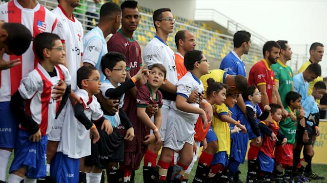 "Disabled children and Brazilian soccer players attend a ""World Boots"" event for children with disabilities, at the Neymar Institute in Praia Grande"