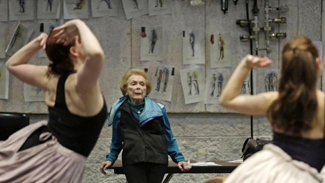 """In this April 26, 2013 photo, choreographer Gemze de Lappe oversees a rehearsal of Rodgers and Hammerstein's """"Oklahoma!"""" at the Lyric Opera of Chicago. De Lappe first danced in """"Oklahoma!"""" in 1943 as a member of the Broadway hit's first national touring company and now 70 years later at age 91 she's choreographing a production of the musical at the Lyric. (AP Photo/M. Spencer Green)"""