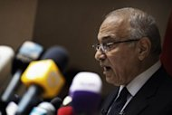 Egyptian presidential candidate and former prime minister Ahmed Shafiq speaks at a press conference in Cairo. Shafiq pledged Saturday to restore the country's revolution