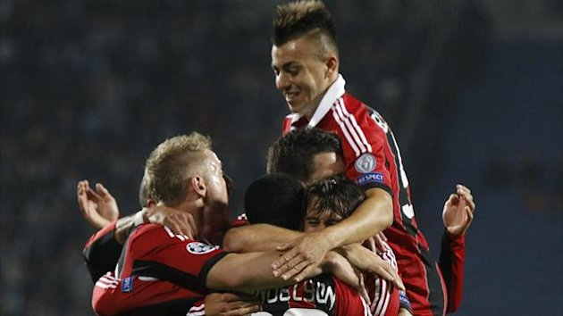 Milan celebrate their opening goal against Zenit