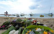 Offerings are left on Semawang beach on Indonesia's resort island of Bali on February 19, 2014 after a scuba diving accident involving Japanese women. Five divers were rescued and two killed, with the final body found only March 17, 2014