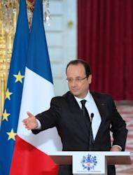 France's President Francois Hollande delivers a speech after European aerospace giant Airbus and Indonesia's Lion Air signed a contract, on March 18, 2013, during a ceremony at the Elysee presidential palace in Paris.