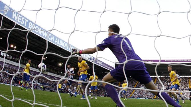 West Bromwich Albion's Yacob rises above the Arsenal defence to score with a header during their English Premier League soccer match in West Bromwich