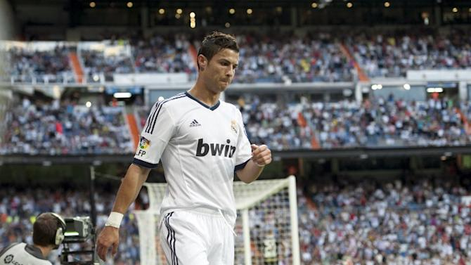 Real Madrid's Portuguese forward Cristiano Ronaldo celebrates his first goal on September 2, 2012 during a Spanish Liga football match against Granada at the Santiago Bernabeu stadium in Madrid. AFP PHOTO