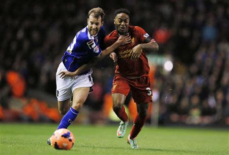 Oldham Athletic's Dayton challenges Liverpool's Sterling during their FA Cup third round soccer match at Anfield in Liverpool