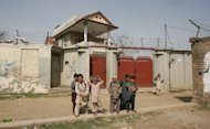 Pakistani children stand outside a suspected former home of Osama bin Laden in Haripur, around 50 kilometers from Islamabad