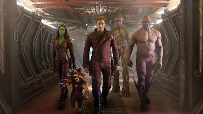 """FILE - This undated image released by Disney - Marvel shows, from left, Zoe Saldana, the character Rocket Racoon, voiced by Bradley Cooper, Chris Pratt, the character Groot, voiced by Vin Diesel and Dave Bautista in a scene from """"Guardians Of The Galaxy"""".(AP Photo/Disney - Marvel, File)"""