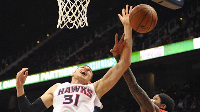 Teague, Millsap lead Hawks to OT win over Raptors