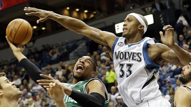 Boston Celtics' Jared Sullinger, second from left, attempts to shoot as Minnesota Timberwolves' Dante Cunningham, right, attempts to block it in the second half of an NBA basketball game on Saturday, Nov. 16, 2013, Minneapolis. The Timberwolves won 106-88