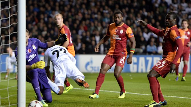 Galatasaray AS's goalkeeper Eray Iscan, left, Aurelien Chedjou of Cameroon, second right, and Emmanuel Eboue of Ivory Coast, right, looks as FC Copenhagen's Daniel Braaten of Norway, 2nd left, scores the opening goal with his heel during their Champions League Group B soccer match at Parken Stadium, Copenhagen, Denmark, Tuesday Nov. 5, 2013