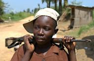 Picture from 2003 of Isembo, who claimed to be have been a rebel fighter in DR Congo since he was 12. The International Criminal Court jailed Congolese warlord Thomas Lubanga for 14 years Tuesday for using child soldiers in his rebel army, the first sentence to be handed down by the world's only permanent war crimes tribunal