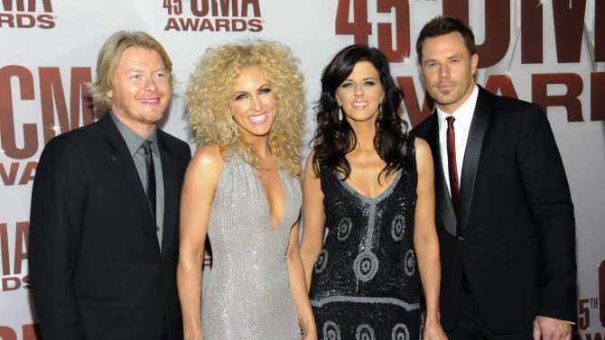 "FILE - In this Nov. 9, 2011 file photo, from left, Phillip Sweet, Kimberly Schlapman, Karen Fairchild and Jimi Westbrook of Little Big Town arrive at the 45th Annual CMA Awards in Nashville. Little Big Town will perform a song called ""Here's Hope"" at the Academy of Country Music Awards, co-written by ACM new artist of the year nominee Hunter Hayes, to raise awareness about child hunger in the United States. (AP Photo/Evan Agostini, file)"