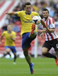 Arsenal's Mesut Ozil controls the ball during their English Premier League soccer match against Sunderland at The Stadium of Light in Sunderland, northern England, September 14, 2013. REUTERS/Nigel Roddis