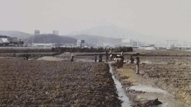 "This photo taken in 1980s shows the scenery of Gangnam area in Seoul, South Korea. Gangnam is the most coveted address in Korea now, but less than two generations ago it was little more than some forlorn homes surrounded by flat farmland and drainage ditches. Now about 1 percent of Seoul's population lives there, but many of its residents are very rich. South Korean rapper PSY's ""Gangnam Style"" video has more than 200 million YouTube views and counting, and it's easy to see why. Gangnam is only a small slice of Seoul, but it inspires a complicated mixture of desire, envy and bitterness. It's also the spark for PSY's catchy, world-conquering song. (AP Photo/Yonhap, Lee Sung-kyu) KOREA OUT"