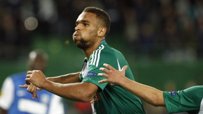 Rapid Vienna's Terence Boyd celebrates after scoring his second goal during their Europa League soccer match against Genk in Vienna