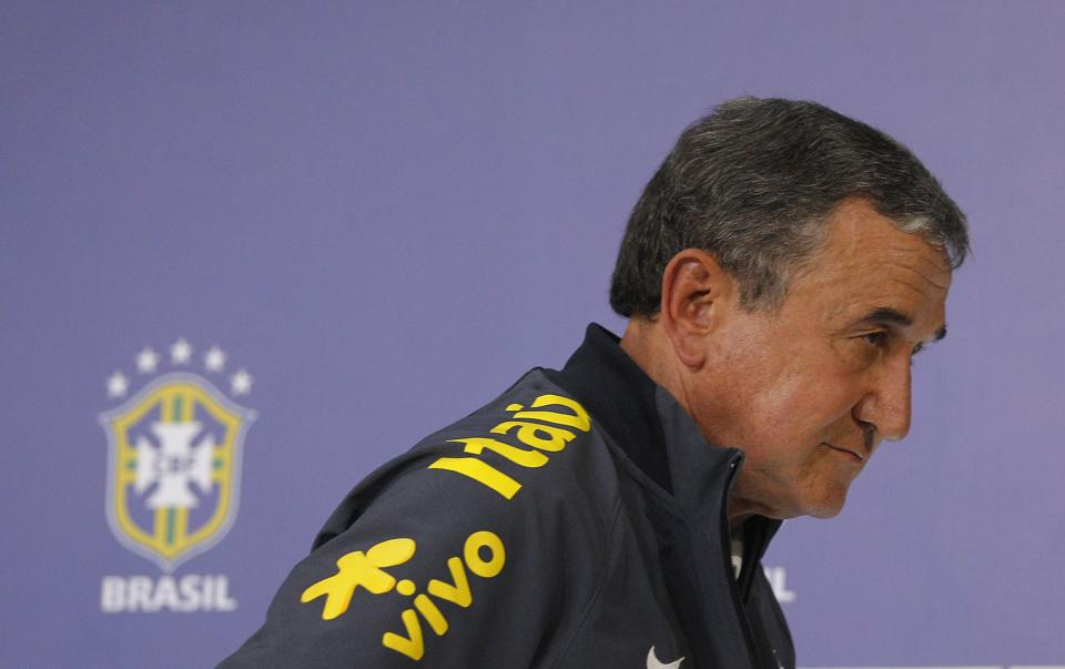 Brazil's team coordinator Carlos Alberto Parreira leaves after attending a press conference at the Granja Comary training center in Teresopolis...