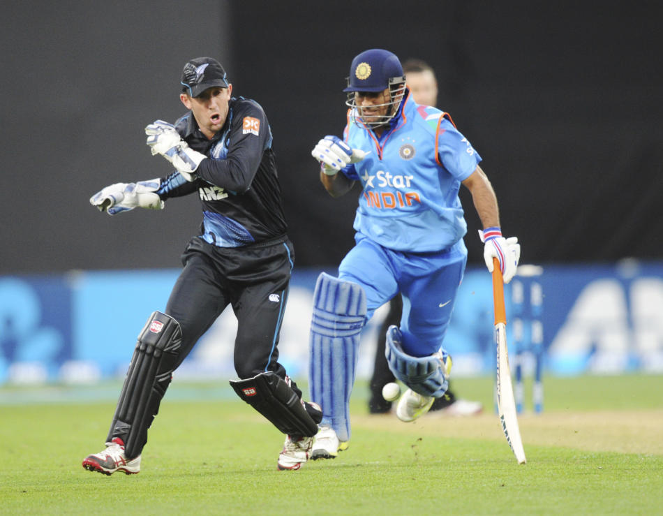 New Zealand's Luke Ronchi, left, and India's MS Dhoni bump eachother during the fifth one day International cricket match at Westpac Stadium in Wellington, New Zealand, Friday, Jan. 31, 2014. (AP