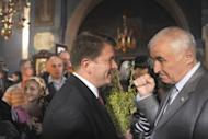 Presidential candidates, former local head of the KGB security service Leonid Tibilov (R) and human rights commissioner David Sanakoyev (L) talk as they visit a church in Tskhinvali, the capital of Georgian maverick region of South Ossetia on April 8, 2012