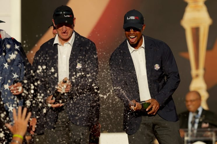 Vice-captains Jim Furyk and vice-captain Tiger Woods of the United States spray champagne after winning the Ryder Cup during the closing ceremony of the 2016 Ryder Cup at Hazeltine National Golf Club on October 2, 2016 in Chaska, Minnesota. (Photo by Streeter Lecka/Getty Images)