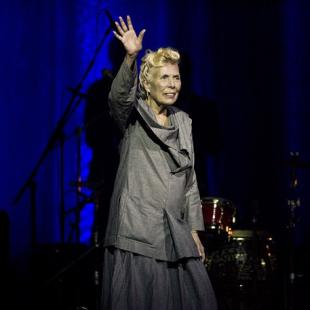 Singer Joni Mitchell has been hospitalized in Los Angeles. Mitchell's website and Twitter account reported Tuesday night that she was in the hospital, but gave no details on her condition. Mitchell is shown waving to the crowd during her 70th birthday tribute concert as part of the Luminato Festival at Massey Hall in Toronto on Tuesday, June 18, 2013. THE CANADIAN PRESS/Aaron Vincent Elkaim