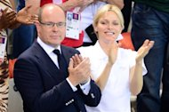 Prince Albert of Monaco and Princess Charlene applaud during the swimming event at the London 2012 Olympic Games at the Olympic Park on July 29, 2012 in London. AFP PHOTO / MARTIN BUREAU