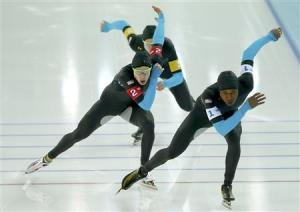 Shani Davis of the U.S. leads Brian Hansen and Jonathan Kuck of the U.S. in the men's speed skating team pursuit quarter-finals during the 2014 Sochi Winter Olympics