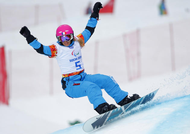 Cecile Hernandez Ep Cervellon of France competes during women's para snowboard cross, standing event at the 2014 Winter Paralympic, Friday, March 14, 2014, in Krasnaya Polyana, Russia. (AP Photo/D