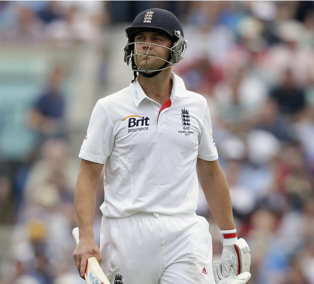 FILE - In this Friday, Aug. 23, 2103 file photo, England's Jonathan Trott walks off the pitch after being given out LBW off the bowling of Australia's Mitchell Starc, following a TV review, du
