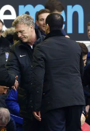 Everton manager Roberto Mart?nez shakes hands with Manchester United manager David Moyes after their English Premier League soccer match in Liverpool