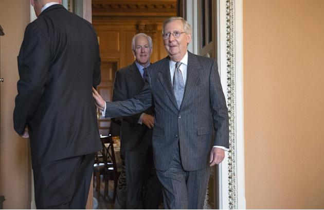 FILE - In this Nov. 17, 2015 file photo, Senate Majority Leader Mitch McConnell of Ky., followed by Senate Majority Whip John Cornyn of Texas, leaves a closed-door GOP policy luncheon on Capitol Hill
