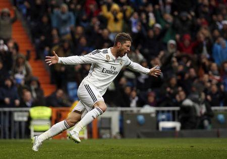 Real Madrid's Ramos celebrates his goal against Real Sociedad during their Spanish first division soccer match at Santiago Bernabeu stadium in Madrid