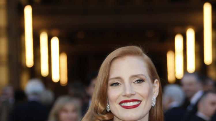 Actress Jessica Chastain arrives at the Oscars at the Dolby Theatre on Sunday Feb. 24, 2013, in Los Angeles. (Photo by Carlo Allegri/Invision/AP)