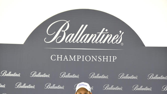 "This handout photo provided by PMG shows Bernd Wiesberger of Austria holding the trophy at the Blackstone Golf Club during the final day of the Ballantine's Championship in Icheon on 29 April, 2012.  The 3 Million USD event is co sanctioned between the Asian and European Tour.    HANDOUT  RESTRICTED TO EDITORIAL USE - MANDATORY CREDIT ""AFP PHOTO / Paul Lakatos / PMG"" - NO MARKETING NO ADVERTISING CAMPAIGNS - DISTRIBUTED AS A SERVICE TO CLIENTS         AFP PHOTO / Paul Lakatos / PMGPAUL LAKATOS/AFP/GettyImages"
