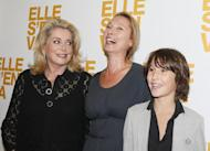 """(From L) French actress Catherine Deneuve flanked by director Emmanuelle Bercot and actor Nemo Schiffman prior to the premiere of their new movie """"Elle s'en va"""" (""""On my way""""), on September 16, 2013 in Paris"""