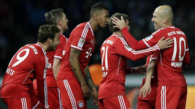 Bayern's Arjen Robben of the Netherlands, right, and scorer Mario Goetze, left, smile as they celebrate their side's second goal during the German Bundesliga soccer match between Hertha BSC Berlin and Bayern Munich in Berlin, Germany, Tuesday, March 25, 2014