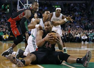 Chuck Hayes controls the ball on the floor while Boston Celtics guard Phil Pressey. (AP)