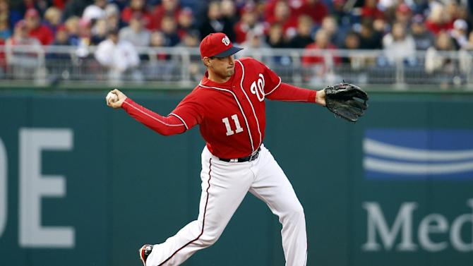 Washington Nationals third baseman Ryan Zimmerman (11) throws to second base during a baseball game against the Atlanta Braves at Nationals Park Saturday, April 5, 2014, in Washington. (AP Photo/Alex Brandon)
