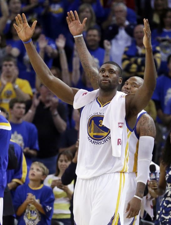 Golden State Warriors' Festus Ezeli, front, and Marreese Speights celebrate the team's 133-126 defeat of the Denver Nuggets in an NBA basketball game Wednesday, April 15, 2015, in Oakland, Cal