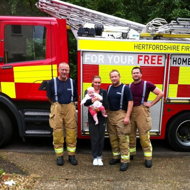Michelle Heaton and her daughter Faith with some firemen