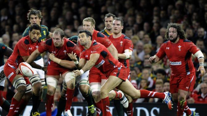 Wales' Mike Phillips passes the ball from the scrum against South Africa during the international rugby union match at the Millennium Stadium in Cardiff,
