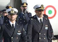 "Italian marines Massimiliano Latorre (right) and Salvatore Girone arrive at Ciampino airport near Rome, on December 22, 2012. Sonia Gandhi -- the Italian-born head of India's ruling party -- has accused Rome of an unacceptable ""betrayal"" as she waded into a bitter dispute over two marines who have skipped bail"