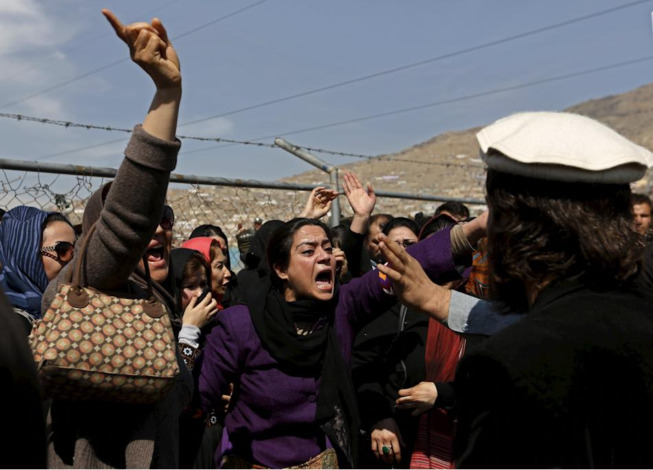 Afghan women's rights activists chant slogans during the funeral ceremony of Farkhunda, an Afghan woman who was beaten to death and set alight on fire on Thursday, in Kabul