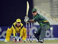 Pakistani cricketer Mohammad Hafeez (R) plays a shot in front of Australian wicketkeeper Matthew Wade during the third and last One Day International cricket match between Pakistan and Australia at the Sharjah cricket stadium. Australia beat Pakistan by three wickets in the third and final one-day international at Sharjah Stadium here on Monday, taking the three-match series 2-1
